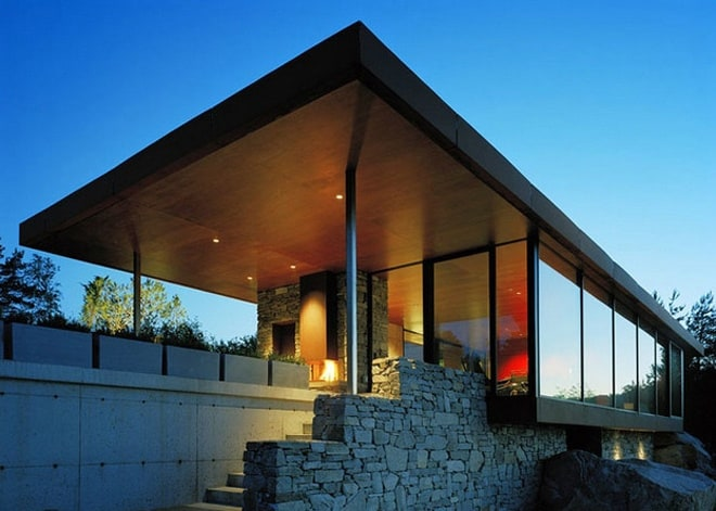 Stone and glass house with a great view in norway for Modern house design norway