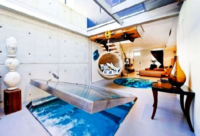 Contemporary Apartment With Aquarium Under Floor Designed