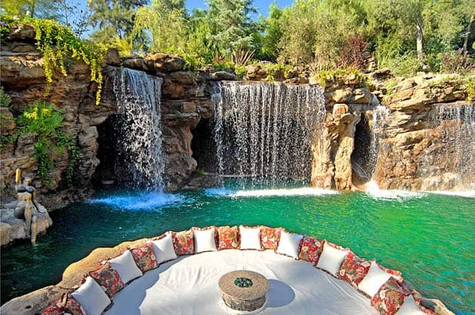 A luxurious pool with a waterfall and a cave at old lion for Luxury pools with waterfalls