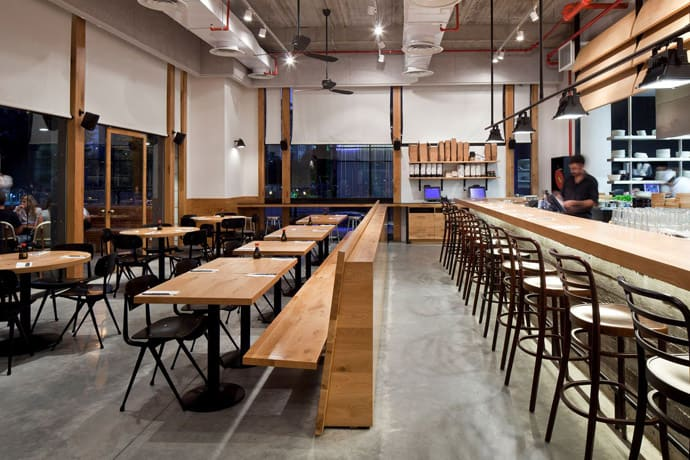 Industrial look wood and concrete for giraffe restaurant for Industrial style homes plans