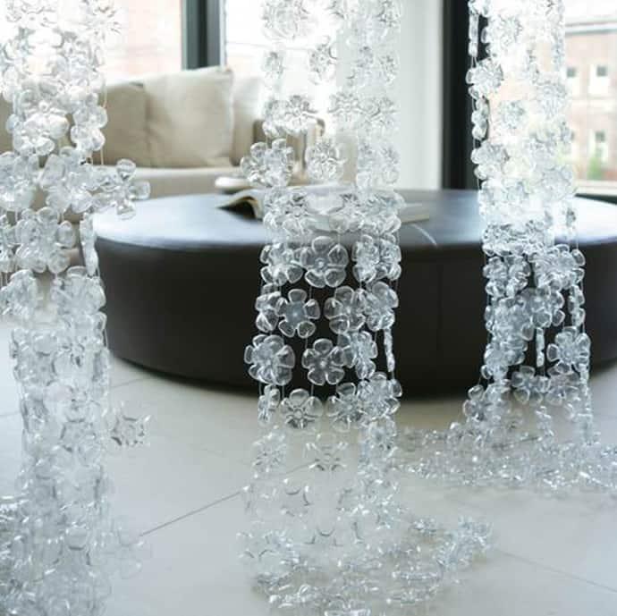 ... flower-like bottoms of plastic bottles for her repurposed creations