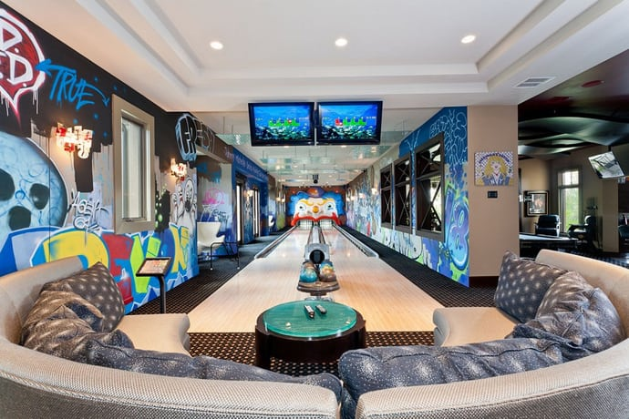 An Entertainment Space With Two Lane Bowling Lanes In A Mansion.