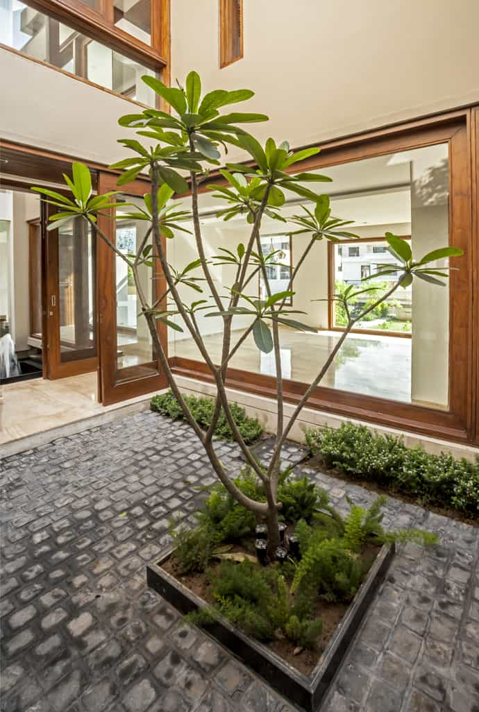 Twin courtyard house by charged voids india for Courtyard house designs india