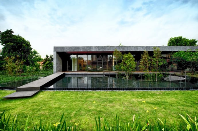 Modern stone house with huge central courtyard by farm for Modern stone house