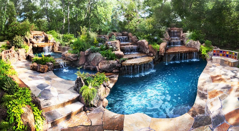 Backyard paradise 30 spectacular natural pools that will for Pool design unique