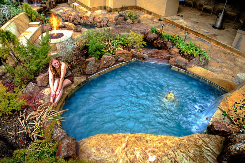 Backyard paradise 30 spectacular natural pools that will for Uses for old swimming pools