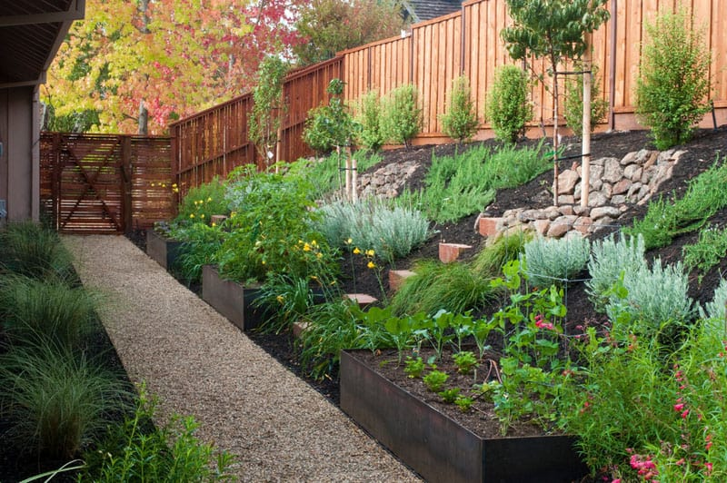 How To Turn A Steep Backyard Into A Terraced Garden on Garden Designs For Sloping Gardens id=23095