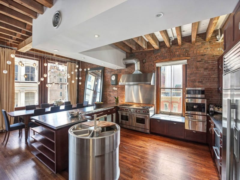 Contemporary SoHo Loft with Exposed Brick and Wood Beams