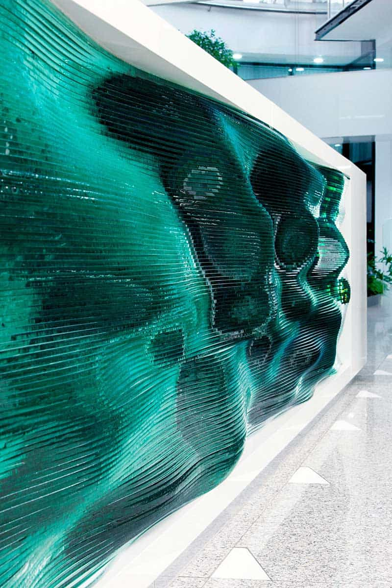A Reception Desk Made By Stacking Layers Of Glass