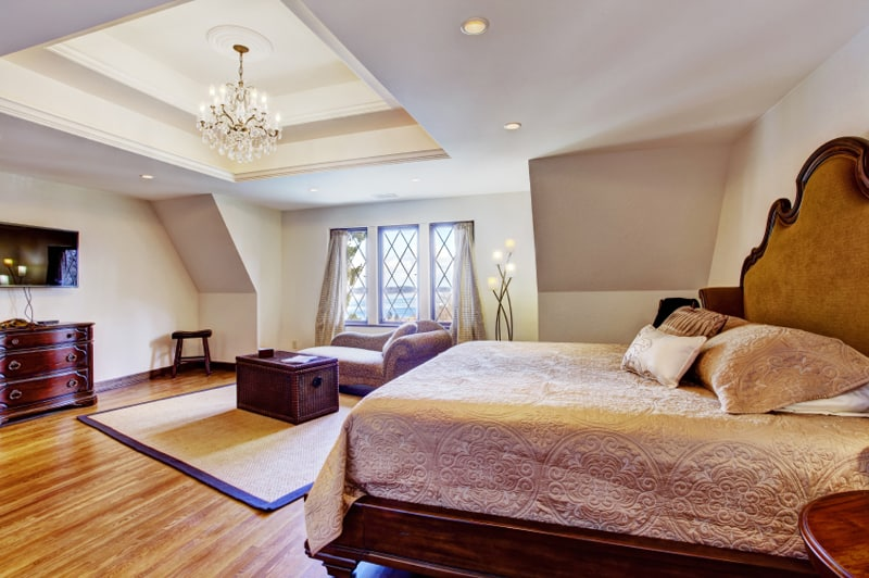 Bright luxury bedroom with design ceiling