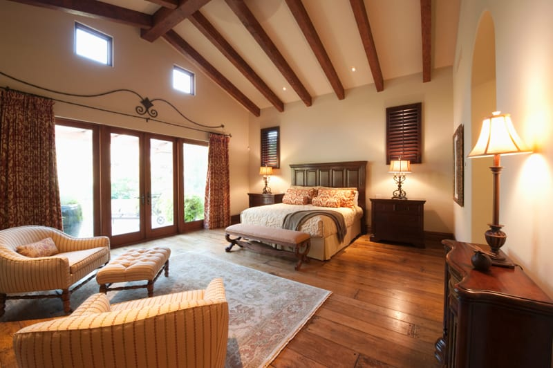 Bedroom With Beamed Wooden Ceiling