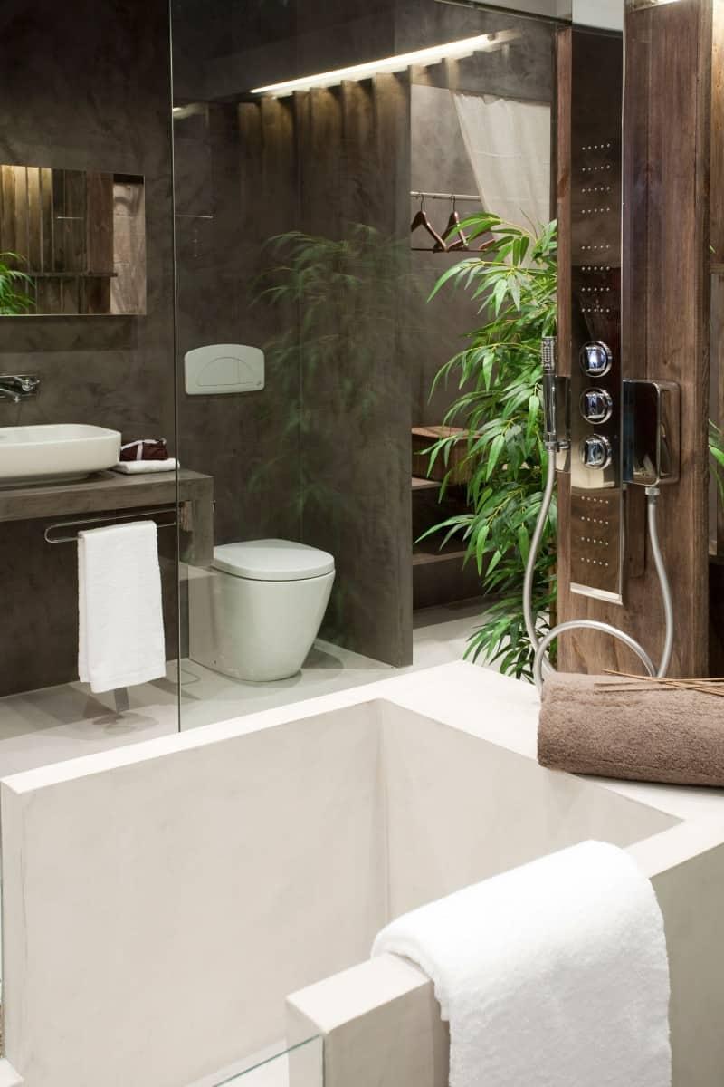 An Exotic Indoor Garden Surrounding A Zen Inspired Bath