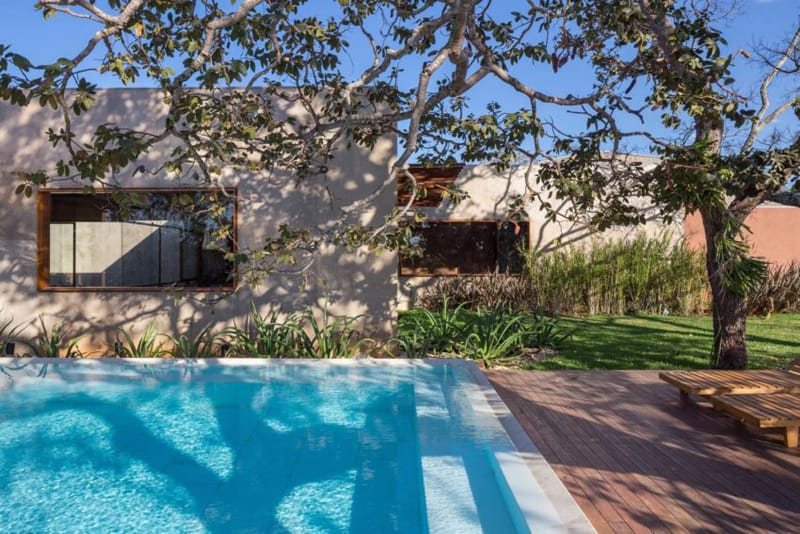 Its Exterior Is Populated By Ravishing Green Gardens, Comfortable Yards, And  A Beautiful Blue Turquoise Pool Surrounded By Tall Trees; Truly A Space  Where ...