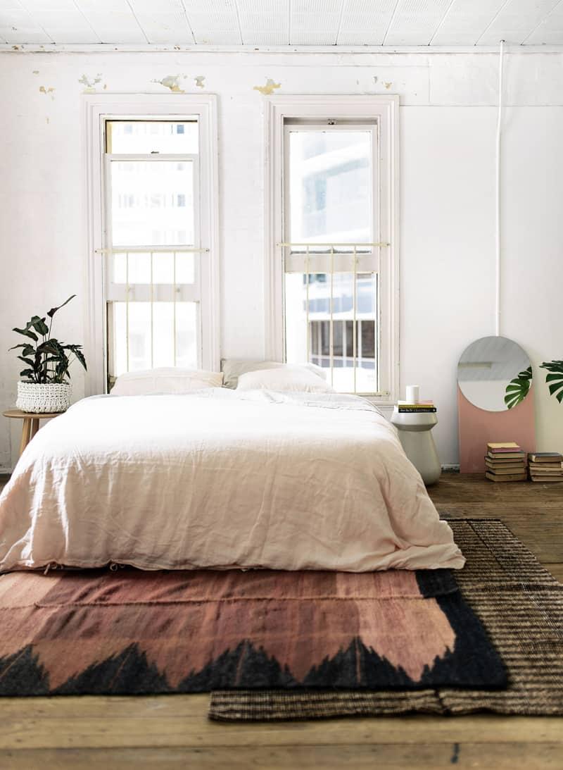 50 ideas for placing a bed in front of a window for Rug in bedroom