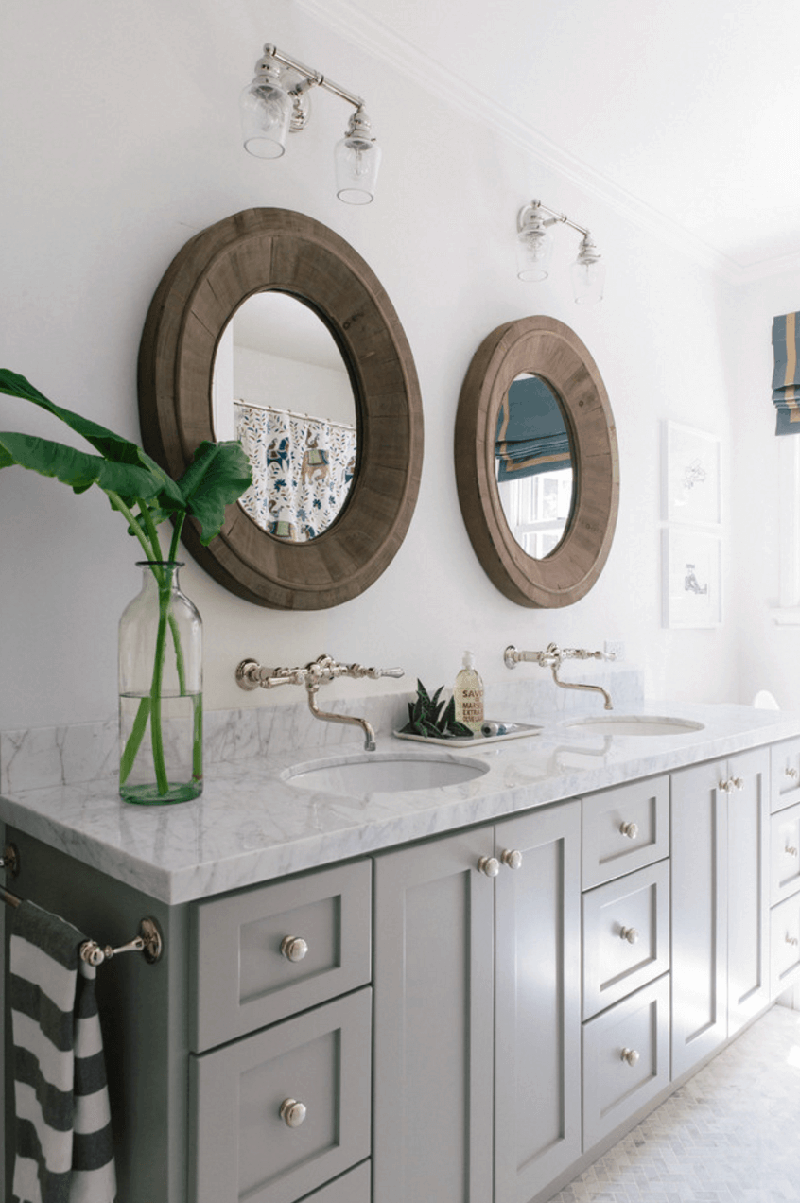 This Pair Of Round/ Oval Bathroom Mirrors Fits Perfectly In A Natural Room.  The Frame Is Curved And Large So You Can Use It As Shelf For Storing  Cosmetics.