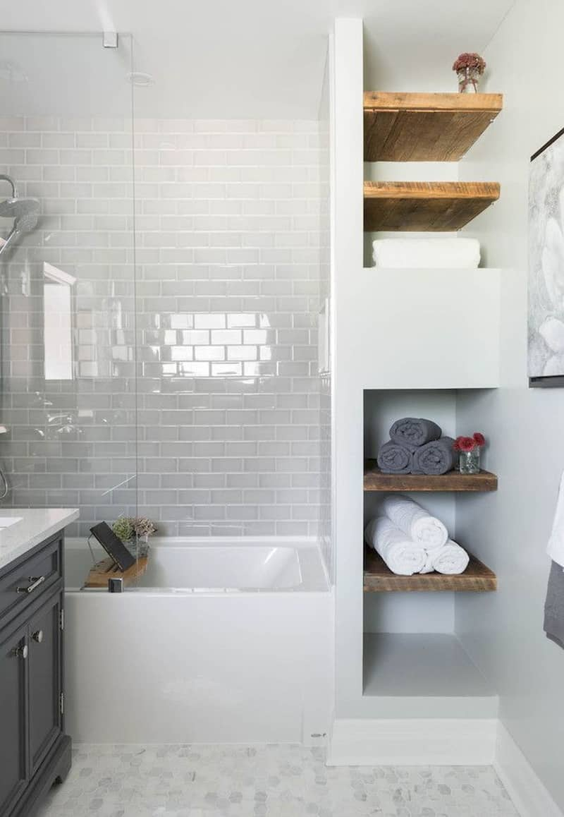 Vintage Separated by a wooden wall the lavatory and the showering area share one open space Cozy and really intimate the room functions as an in between space