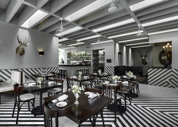 A Stylish White And Black Bar And Tea Restaurant By